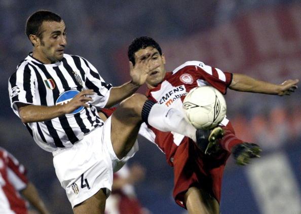 Juventus' Paolo Montero (L) challenge fo