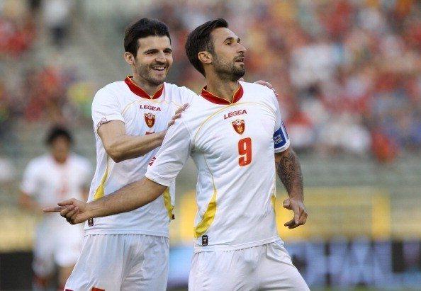 Montenegro's Mirko Vucinic (R) celebrate