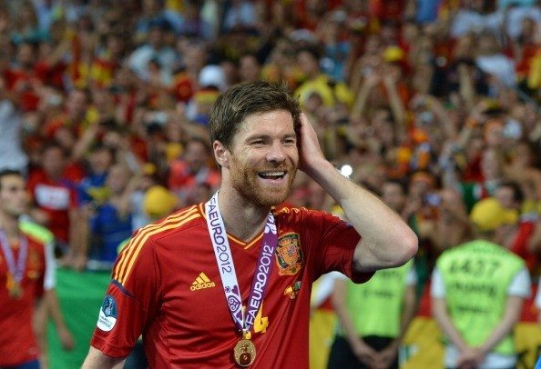 Spanish midfielder Xabi Alonso smiles af
